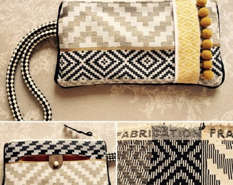 Ethnic-chic clutch with wrist strap.