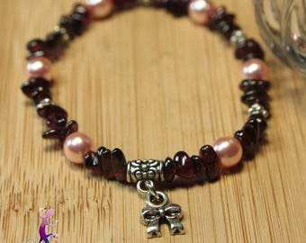 Drives and glass beads with bow charm