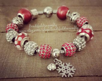 "Stainless Steel/Crystal Holiday Themed Snake Bracelet with SS Snowflake Charm. Comes in 7"" - 8"" Length."
