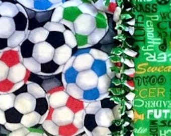 Soccer SuperStar! Handmade fleece blanket designed by JAX. Choose your own size and color fabric to create the perfect soccer team throw