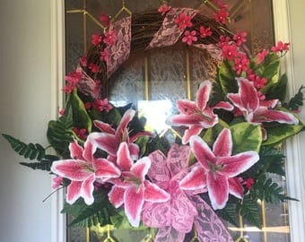 18 inch Grapevine wreath with silk lily flowers.