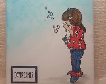 """Little girl blowing bubbles with the phrase """"Daydreamer"""" on canvas"""