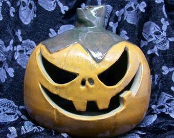 Ceramic pumpkin candle holder