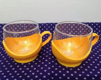 Set of Two Retro Melitta Glass Mugs with Yellow Plastic Cup Holders