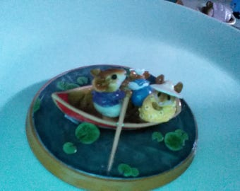 Wee Forest Folk family canoeing on waterlily pond