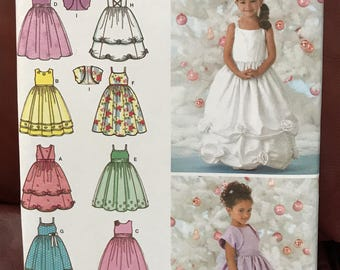 Uncut Simplicity girls' formal dress pattern in 3+ versions with matching shurg