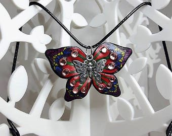 Red and blue butterfly necklace made of polymer clay.