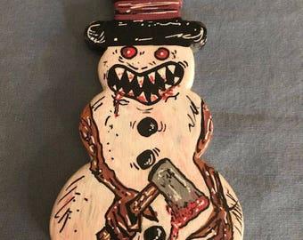 Snowman Ornament holding Hatchet