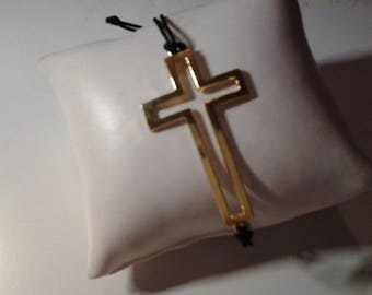 Cross on black cord bracelet