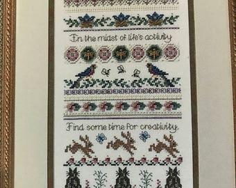 "Just Nan Creativity Counted Cross Stitch pattern, creativity embellishments, 28 count Antique White Cashel  10"" x 18"" fabric"