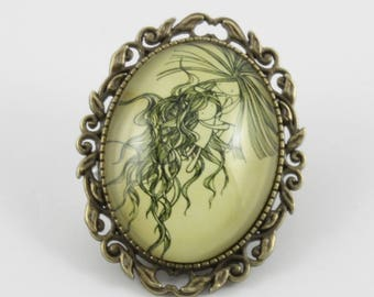"""Reunion"" 40 x 30 mm glass cabochon brooch"