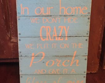 In our home we don't hide crazy - primitive sign