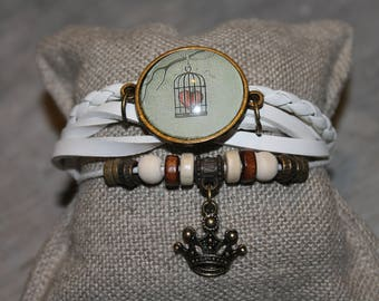 White bracelet with caged heart cabochon