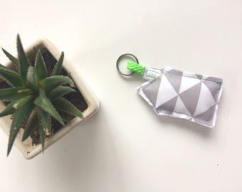 Door keys home grey triangles and neon green cord
