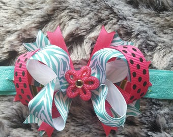 light blue zebra stripes with  hot pink polkadot ribbon