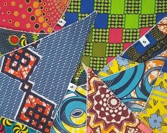 Towel-backed soft, vibrant bandana bibs in eye-catching African print fabrics