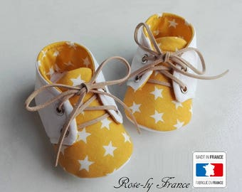 White Star (baby shoes) and yellow baby booties