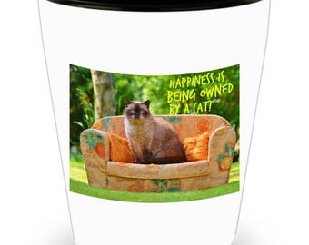 Happiness Is Being Owned By A Cat! Funny, Chubby Siamese Cat Perched Upon A Sofa Throne on Cool Ceramic Shot Glass Makes a Perfect Gift!