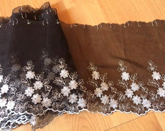 Embroidered lace on black tulle with grey thread