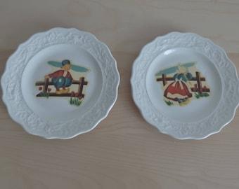 vintage plates with Dutch children decoration
