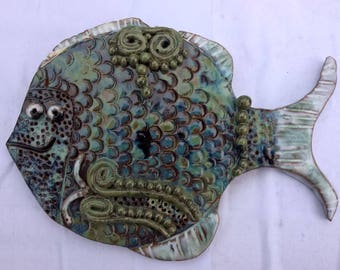 Beautiful hand made multicoloured fish wall plaque.