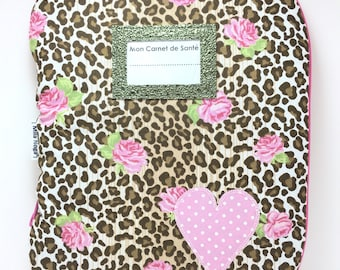 Protects health record printed pink and fawn with label and applying heart door