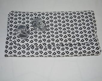 Purse pouch for toothbrush and toothpaste.