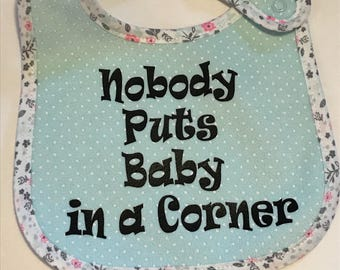 Nobody Puts Baby in a Corner baby bib for your Baby!  Durable baby bib with plastic backing
