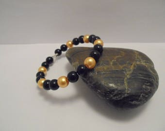 Beaded black and gold beads