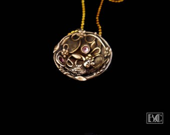 """Nest"" golden bronze pendant"