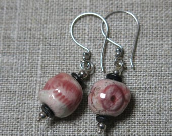 Raku earrings: pale pink beads with cowri and geometric pattern and Bali silver hooks
