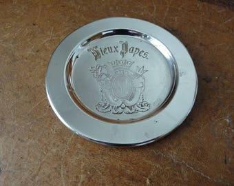 Vintage 'Vieux Papes' silver wine bottle coaster