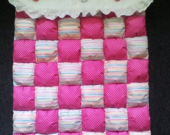 Handmade baby quilt suitable for crib, pram or pushchair.