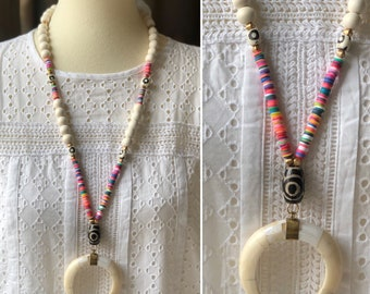 White horn with polymer clay sewuin beads.
