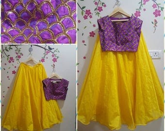 yellow lehanga with purple crop top