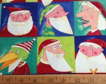1.5 yards of Christmas/Santa/Mrs Claus/Reindeer blocks multi-color cotton fabric