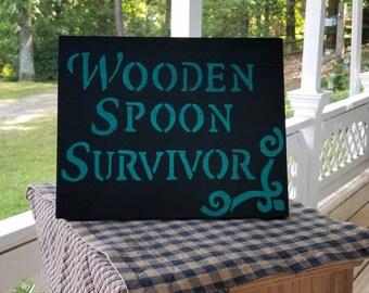 Wooden spoon survivor home decor sign