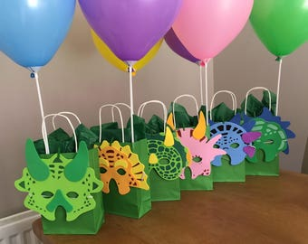 Green Dinosaur party bags with dinosaur mask and balloon
