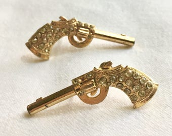 Gold and rhinestone revolver earrings