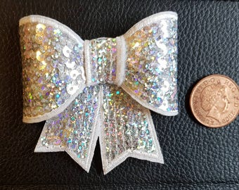 Large sequin silver bow