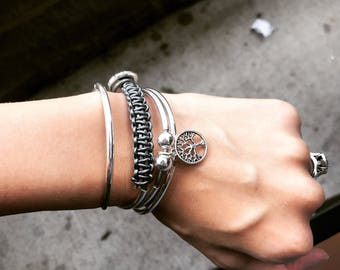 Silver leather wrap charm bracelet with button clasp
