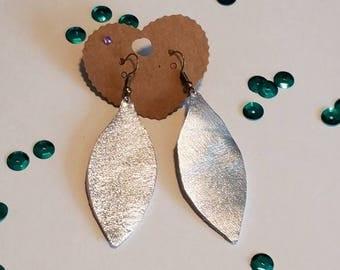 Hand cut leather earrings in silver