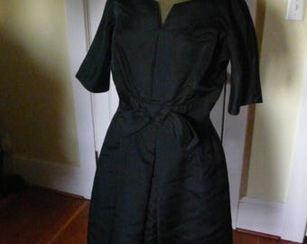 1950s LBD.  Black Taffeta, Fit and Flare, Bow at Waist. Size 6.