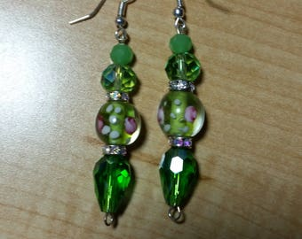 Green glass faceted crystals and Lampwork glass beads make up this stunning pair of dangle earrings