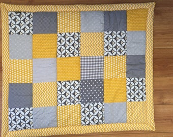 mustard and grey patchwork blanket