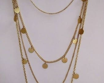 Vintage pre-owned multi strand gold coins sequined long layered chains necklace.
