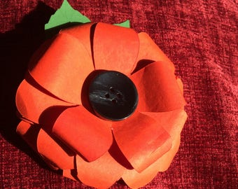 A Handmade Paper Flower with Button Centre.