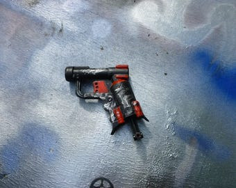 Red and Black Nerf Jolt with distressed weathering