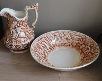 Hand-made ceramic set .A pitcher with a bowl.