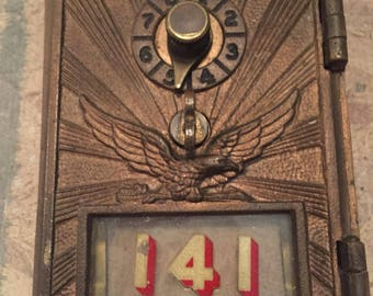 Antique brass post office mailbox door, single dial with raised eagle and sunburst - small